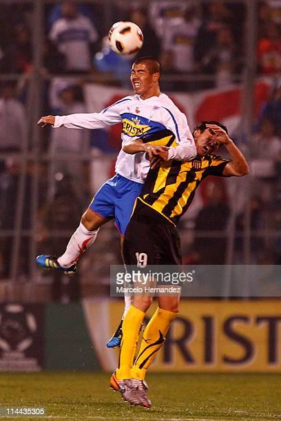 Juan Manuel Olivera of Penarol struggles for the ball with Francisco Silva of Universidad Catolica during the Santander Libertadores Cup 2011 at San...