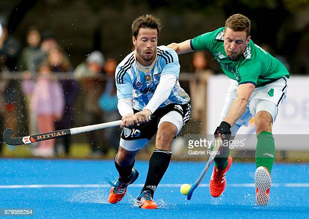 Juan Manuel Saladino of Argentina fights for the ball with Jonathan Bell of Ireland during an International Friendly match between Argentina and...