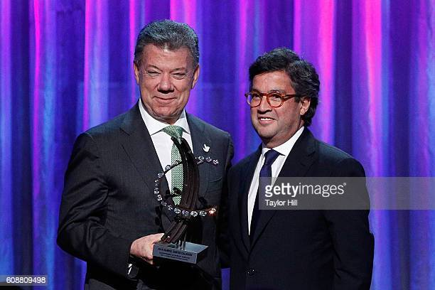 Juan Manuel Santos Calderon accepts an award from Luis Moreno during the 2016 Clinton Global Citizen Awards during the Clinton Global Initiative...