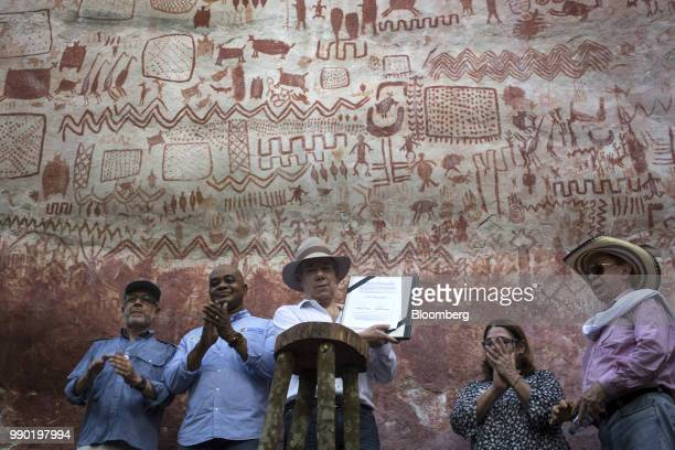 Juan Manuel Santos Colombia's president center displays the document declaring Chiribiquete National Park a world heritage site during a tour of the...