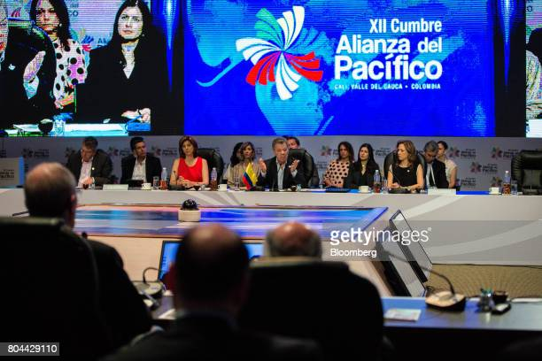Juan Manuel Santos Colombia's president center speaks during the Pacific Alliance Summit in Valle del Cauca Department Cali Colombia on Friday June...