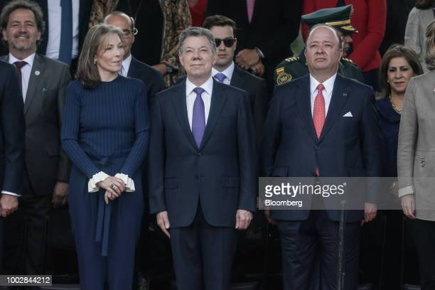 Juan Manuel Santos Colombia's president center stands with his wife Maria Clemencia Rodriguez Munera Colombia's first lady left and Luis Carlos...
