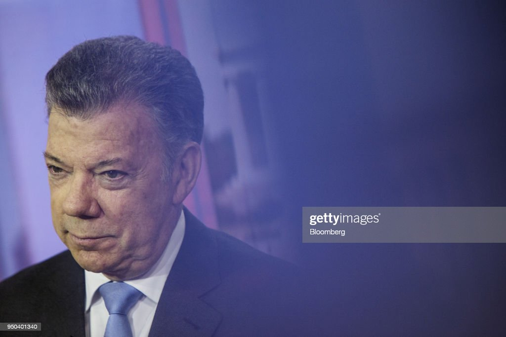 Juan Manuel Santos, Colombia's president, listens during a Bloomberg Television interview in New York, U.S., on Monday, April 23, 2018. Santosdiscussed the Colombian peace agreement, the nation's economy, and the Venezuelan migration crisis. Photographer: Victor J. Blue/Bloomberg via Getty Images