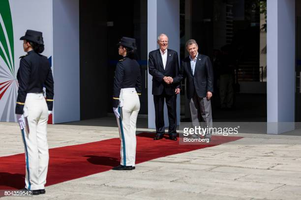 Juan Manuel Santos Colombia's president right shakes hands with Pedro Pablo Kuczynski Peru's president while arriving to the Pacific Alliance Summit...
