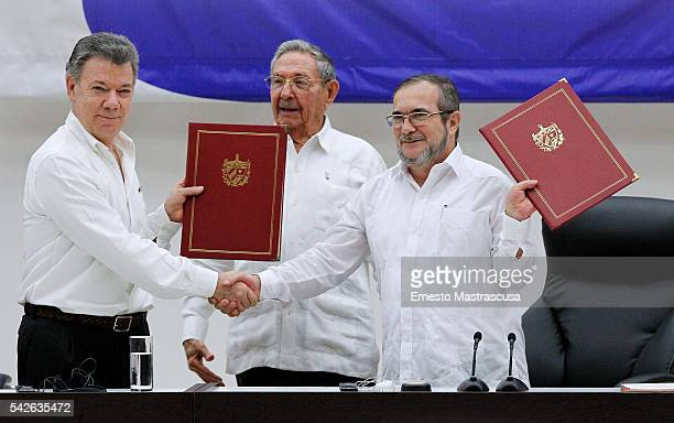 Juan Manuel Santos president of Colombia and Timoleon Jimenez 'Timonchenko' shake hands shake hands during a ceremony to sign a historic ceasefire...