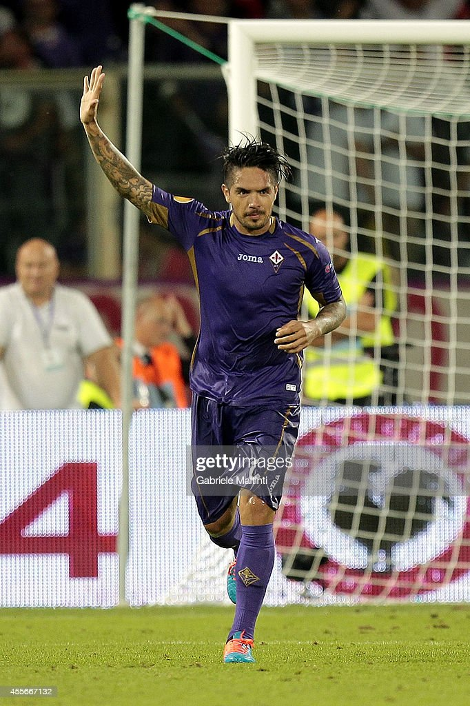 Juan Manuel Vargas of ACF Fiorentina celebrates after scoring a goal during the UEFA Europa League group K match between ACF Fiorentina and EA Guingamp at Stadio Artemio Franchi on September 18, 2014 in Florence, Italy.
