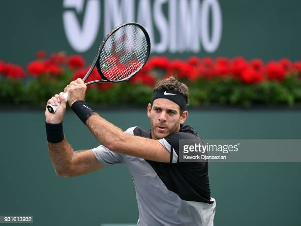 Juan Martin Del Porto of Argentina hits a backhand against David Ferrer of Spain during Day 9 of BNP Paribas Open on March 13 2018 in Indian Wells...