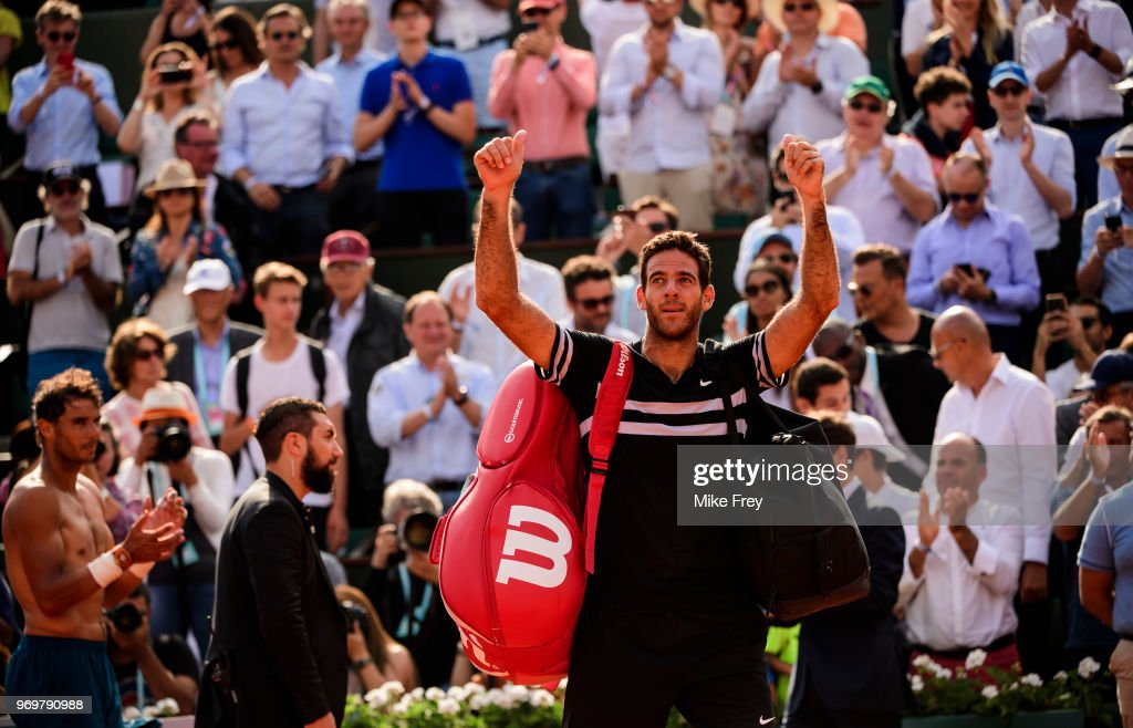 Juan Martin Del Porto of Argentina waves to the crowd after losing to an applauding Rafael Nadal of Spain 6-5 6-1 6-2 in the semi finals of the men's singles at Roland Garros during the French Open on June 8, 2018 in Paris, France.