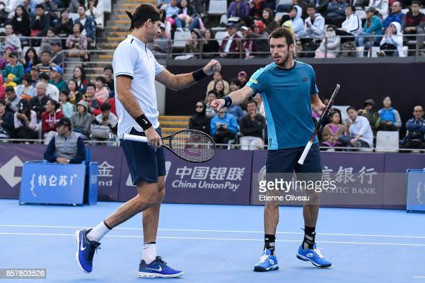 Juan Martin del Potro and Leonardo Mayer of Argentina check hands during their Men's doubles quarterfinal match against Paolo Lorenzi of Italy and...