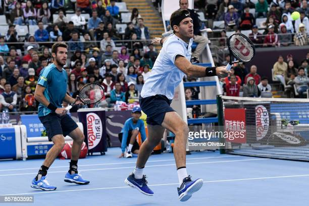 Juan Martin del Potro and Leonardo Mayer of Argentina in action against Paolo Lorenzi of Italy and Mischa Zverev of Germany during their Men's...