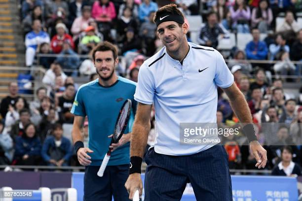 Juan Martin del Potro and Leonardo Mayer of Argentina smile after missing a point during their Men's doubles quarterfinal match against Paolo Lorenzi...