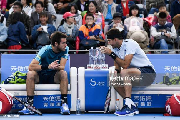 Juan Martin del Potro and Leonardo Mayer of Argentina talk tactics during their Men's doubles quarterfinal match against Paolo Lorenzi of Italy and...