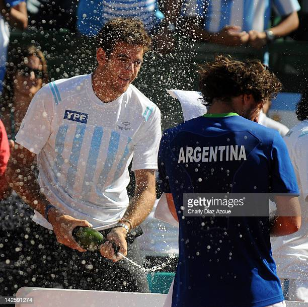 Juan Martin Del Potro celebrates with teammate Juan Monaco after the match between Argentina and Croatia for the quarterfinals of the Davis Cup at...