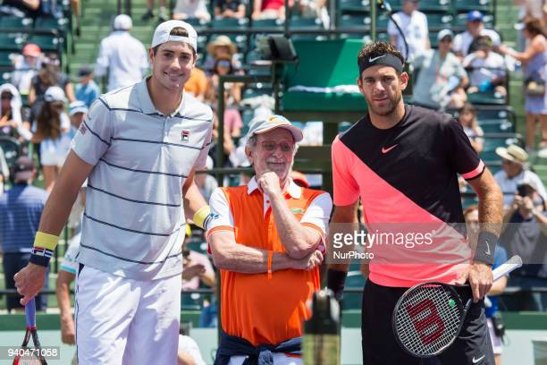 Juan Martin Del Potro from Agentina and John Isner from the USA pose at the net before the match with Jaques Lewkowicz a guest from Itau Bank the...