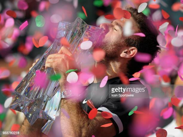 Juan Martin Del Potro kisses the winners trophy after defeating Roger Federer to become the 2018 BNP Paribas Open Champion after a finals match...
