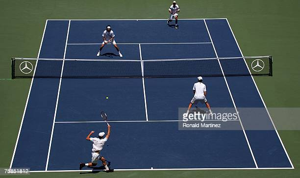 Juan Martin Del Potro of Argentina and Travis Parrott play a point with Teimuraz Gabashvili of Russia and Ivo Karlovic during the doubles final of...
