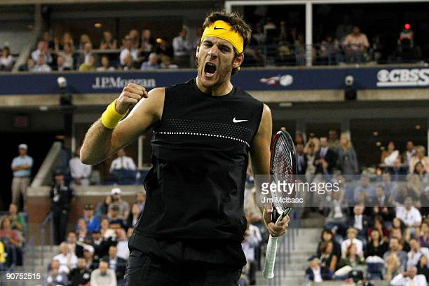Juan Martin Del Potro of Argentina celebrates a point in the fifth set against Roger Federer of Switzerland during the Men's Singles final on day...