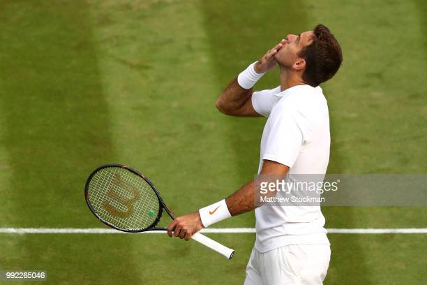 Juan Martin del Potro of Argentina celebrates after defeating Feliciano Lopez of Spain in their Men's Singles second round match on day four of the...