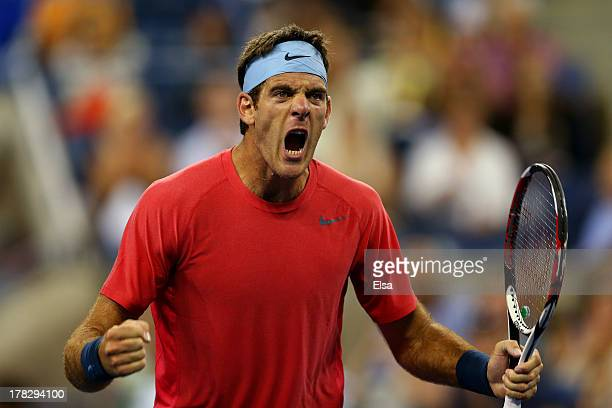 Juan Martin Del Potro of Argentina celebrates after defeating Guillermo GarciaLopez of Spain in their men's singles first round match on Day Three of...
