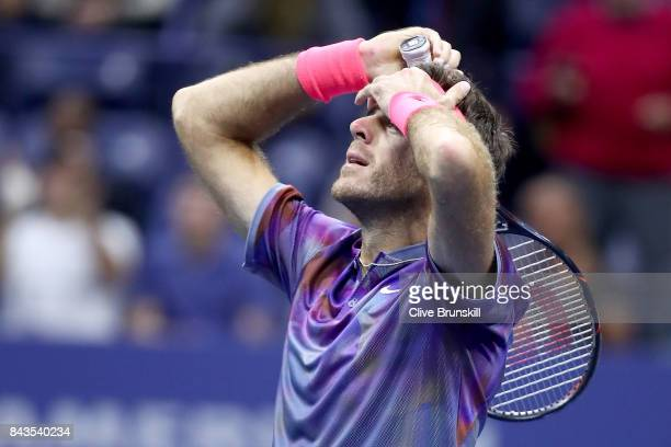 Juan Martin del Potro of Argentina celebrates after defeating Roger Federer of Switzerland in their Men's Singles Quarterfinal match on Day Ten of...