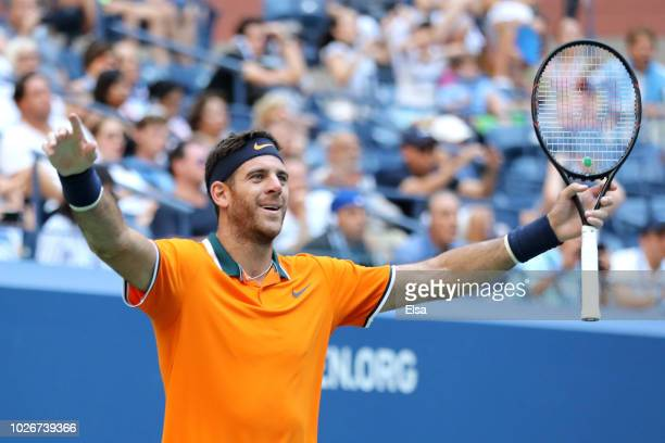Juan Martin Del Potro of Argentina celebrates at match point during the men's singles quarter-final match against John Isner of The United States on...