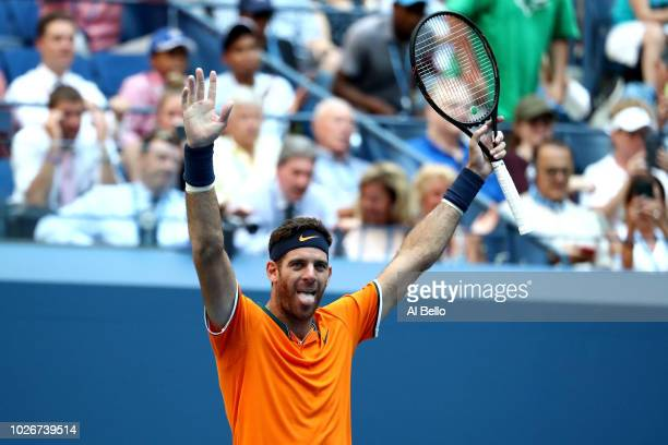 Juan Martin Del Potro of Argentina celebrates at match point during the men's singles quarterfinal match against John Isner of The United States on...