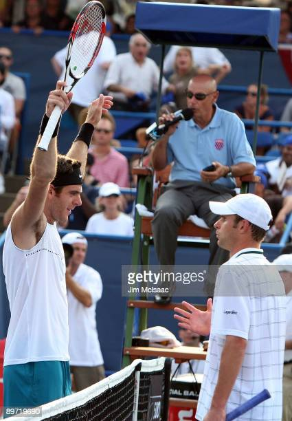 Juan Martin Del Potro of Argentina celebrates at the net after match point was awarded on a challenge against Andy Roddick during Day 7 of the Legg...