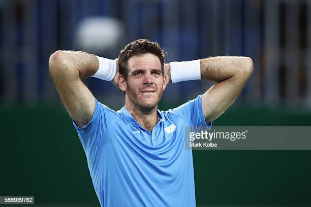 Juan Martin Del Potro of Argentina celebrates match point against Roberto Bautista Agut of Spain in the Men's Singles Quarterfinal on Day 7 of the...