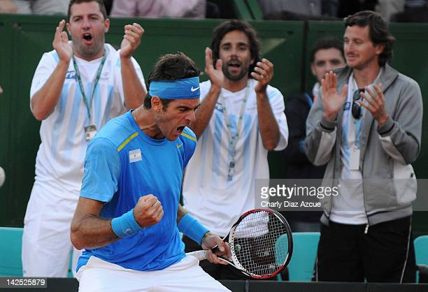Juan Martin Del Potro of Argentina celebrates the victory against Ivo Karlovic of Croatia during the match between Argentina and Croatia for the...