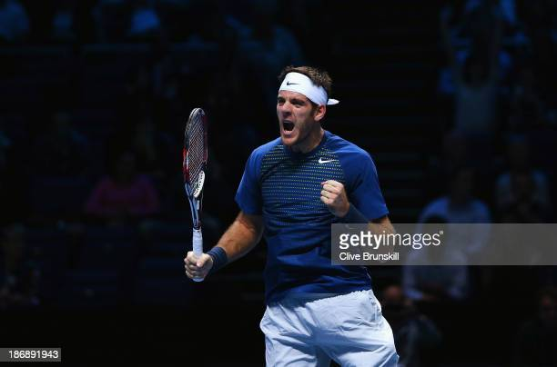 Juan Martin Del Potro of Argentina celebrates winning match point in his men's singles match against Richard Gasquet of France during day one of the...