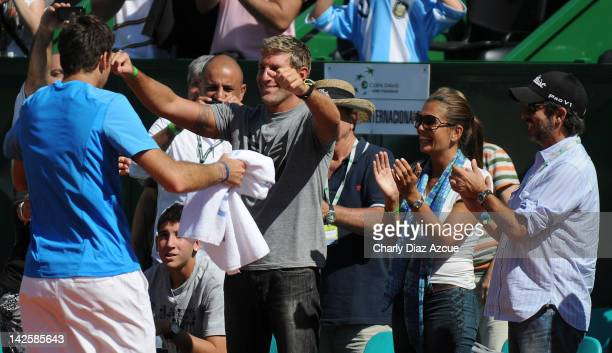 Juan Martin Del Potro of Argentina celebrates with Martin Palermo his girlfriend Jessica Geneux and actor Ricardo Darin after the match between...