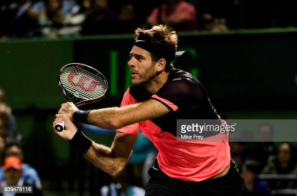 Juan Martin Del Potro of Argentina changes hits a backhand to Milos Raonic of Canada during the quarterfinals match on Day 10 of the Miami Open...