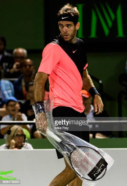 Juan Martin Del Potro of Argentina changes racket against Milos Raonic of Canada during the quarterfinals match on Day 10 of the Miami Open Presented...