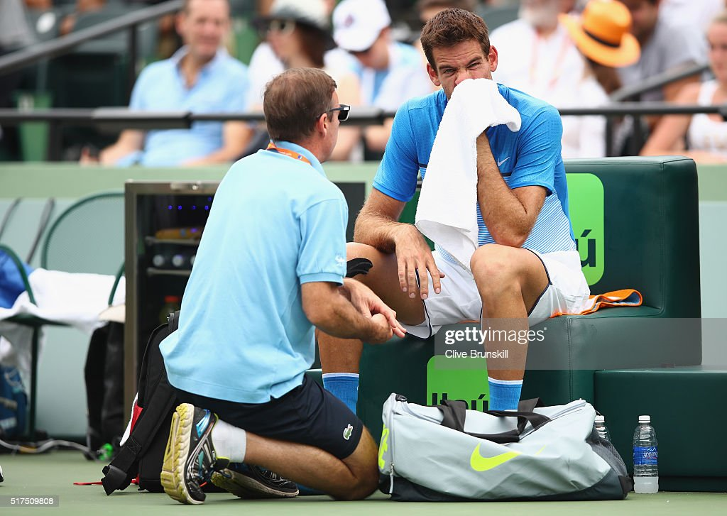 Juan Martin Del Potro of Argentina has his wrist checked by a physio during an injury time out against Horacio Zeballos of Argentina in their second round match during the Miami Open Presented by Itau at Crandon Park Tennis Center at Crandon Park Tennis Center on March 25, 2016 in Key Biscayne, Florida.