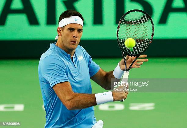 Juan Martin Del Potro of Argentina hits a backhand volley against Marin Cilic of Croatia in the fourth match of the 2016 Davis Cup Final between...