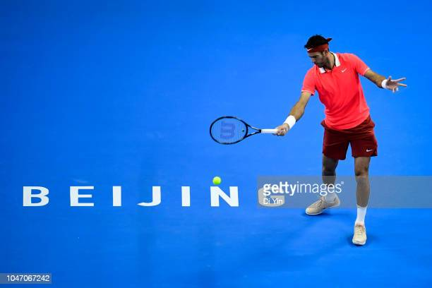 Juan Martin Del Potro of Argentina hits a return against Nikoloz Basilashvili of Georgia during his Men's Singles Finals match in the 2018 China Open...