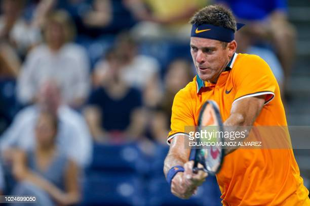 Juan Martin del Potro of Argentina hits a return to Donald Young of US during their 2018 US Open men's Singles match at the USTA Billie Jean King...