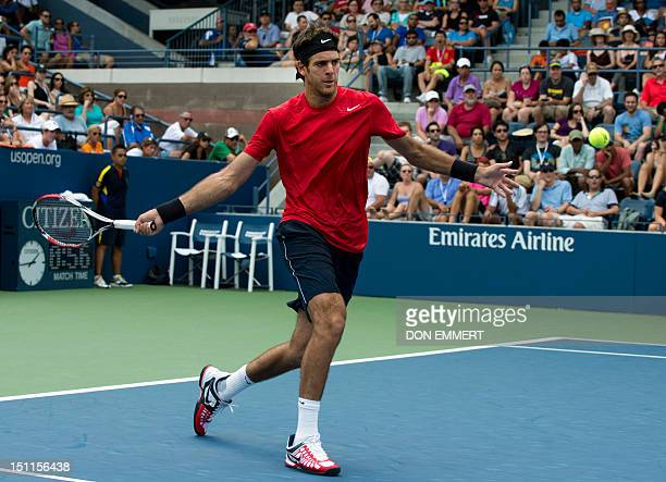 Juan Martin Del Potro of Argentina hits a return to Leonardo Mayer of Argentina during their men's singles third round match at the 2012 US Open...