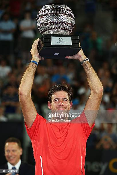 Juan Martin Del Potro of Argentina holds aloft the winners trophy after claiming the mens singles final against BernardTomic of Australia during day...