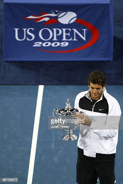 Juan Martin Del Potro of Argentina holds the championship trophy after defeating Roger Federer of Switzerland in the Men's Singles final on day...