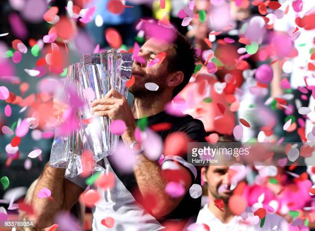 Juan Martin Del Potro of Argentina holds up the trophy after his victory over Roger Federer of Switzerland in the ATP final during the BNP Paribas...