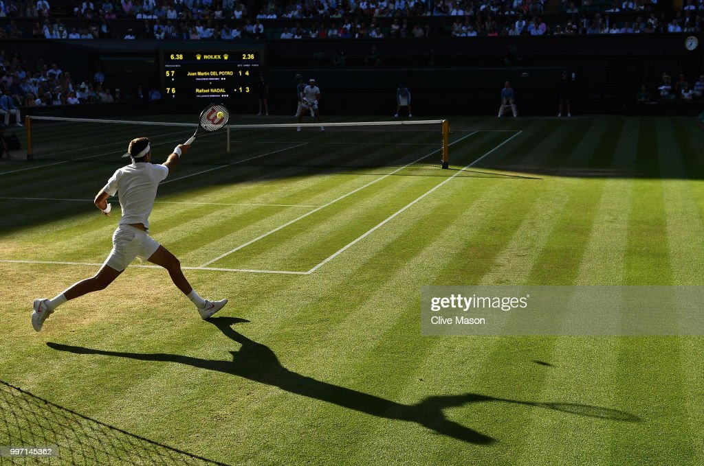 Juan Martin Del Potro of Argentina in action against Rafael Nadal of Spain during their Men's Singles Quarter-Finals match on day nine of the Wimbledon Lawn Tennis Championships at All England Lawn Tennis and Croquet Club on July 11, 2018 in London, England.