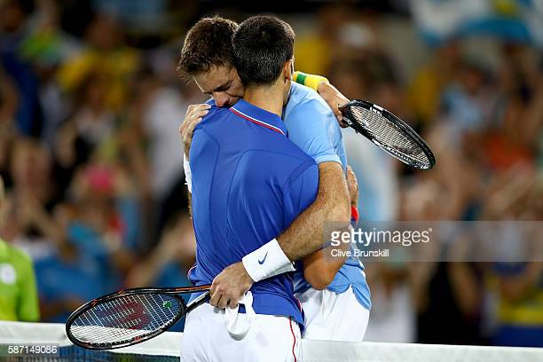 Juan Martin Del Potro of Argentina is congratulated by Novak Djokovic of Serbia after his victory in their singles match on Day 2 of the Rio 2016...