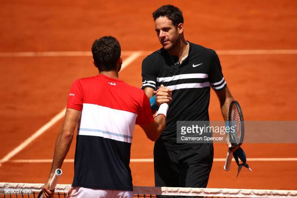 Juan Martin Del Potro of Argentina is congratulated on victory by Marin Cilic of Croatia during day twelve of the 2018 French Open at Roland Garros...