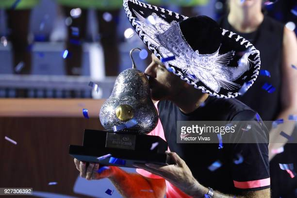 Juan Martin del Potro of Argentina kisses the champion trophy after the Championship match between Kevin Anderson of South Africa and Juan Martin del...