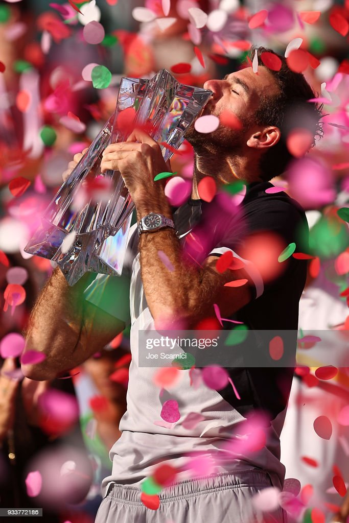 Juan Martin Del Potro of Argentina kisses the winner's trophy after beating Roger Federer of Switzerland in three sets at the BNP Paribas Open on March 18, 2018 in Indian Wells, California.