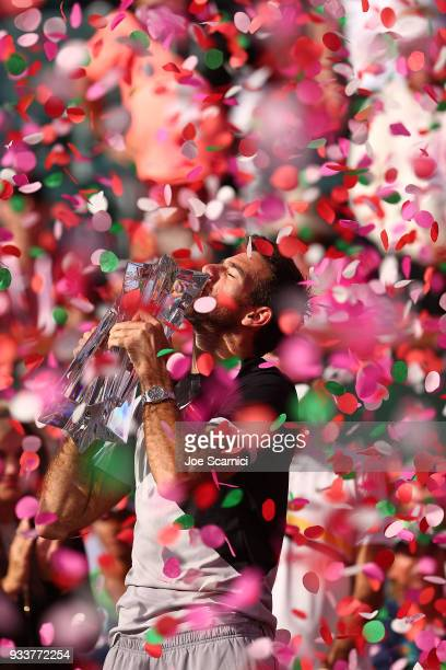 Juan Martin Del Potro of Argentina kisses the winner's trophy after beating Roger Federer of Switzerland in three sets at the BNP Paribas Open on...