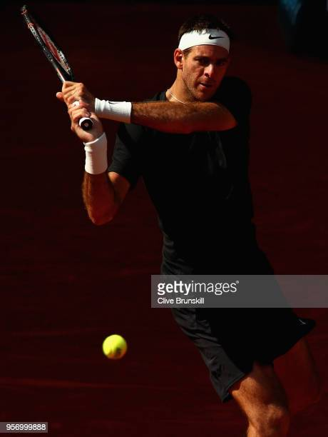 Juan Martin Del Potro of Argentina plays a backhand against Dusan Lajovic of Serbia in their third round match during day six of the Mutua Madrid...