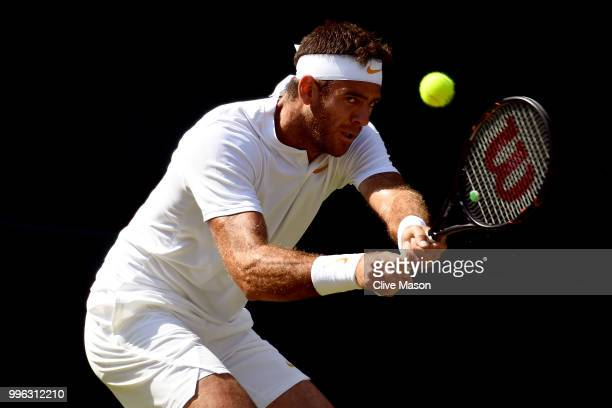 Juan Martin Del Potro of Argentina plays a backhand against Rafael Nadal of Spain during their Men's Singles Quarter-Finals match on day nine of the...