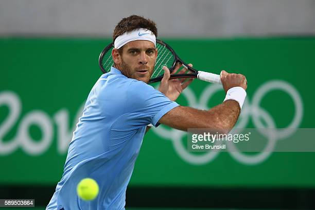 Juan Martin Del Potro of Argentina plays a backhand during the men's singles gold medal match against Andy Murray of Great Britain on Day 9 of the...